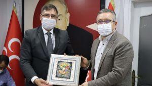 Kuşadası MHP'ye AK Parti ilçe yönetiminden iadeyi ziyaret