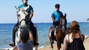 Kuşadası'ndaki milli parkın sahilleri atlı jandarma timine emanet